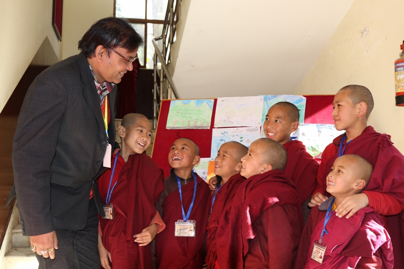 Shechen school principal with students